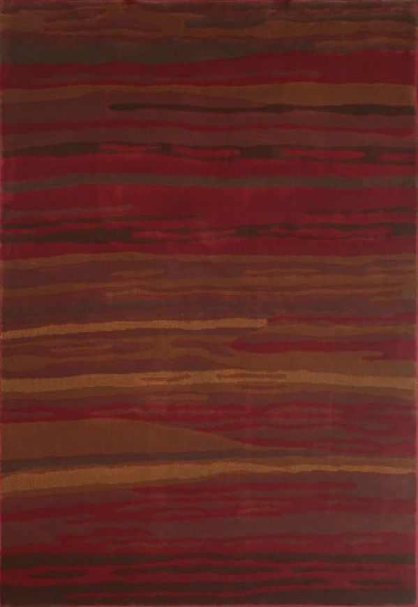 "Look to the Canyon Rio rug for a ""striped"" canyon landscape bursting with rich reds and golden br..."